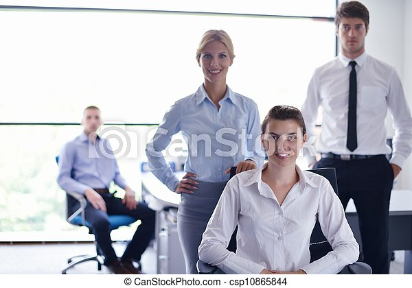 business woman with her staff in background at office - csp10865844