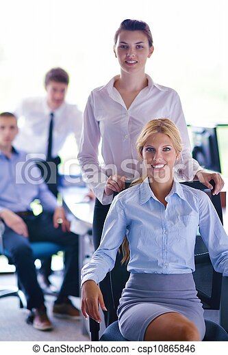 business woman with her staff in background at office - csp10865846