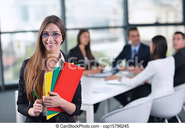 business woman with her staff in background at office - csp15796245