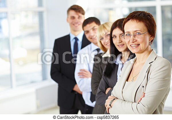 Business woman with her team - csp5837265