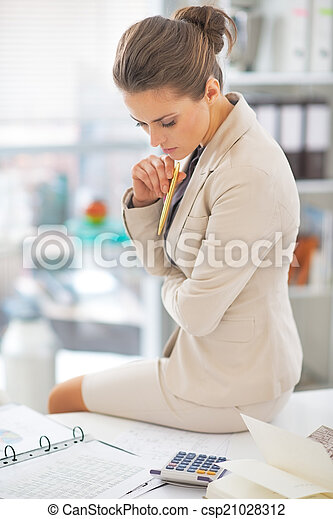 Business woman working in office - csp21028312
