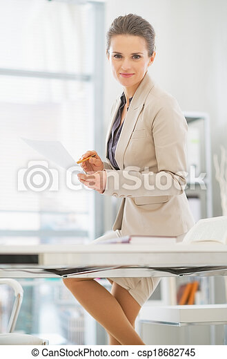 Business woman working in office - csp18682745