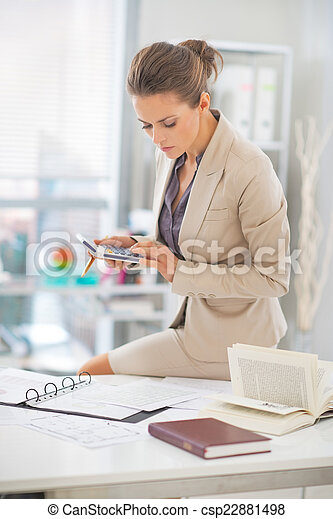 Business woman working in office - csp22881498