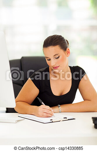 business woman writing report - csp14330885