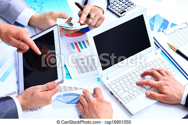Business work-group analyzing financial data in office - csp16901050