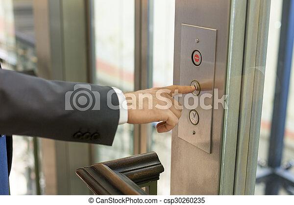 Businessan pressing elevator button - csp30260235
