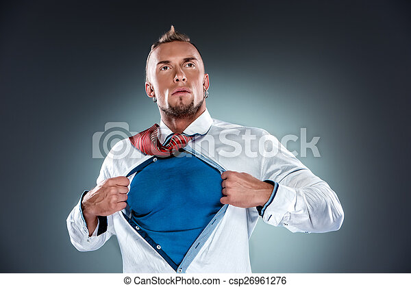 businessman acting like a super hero and tearing his shirt off - csp26961276