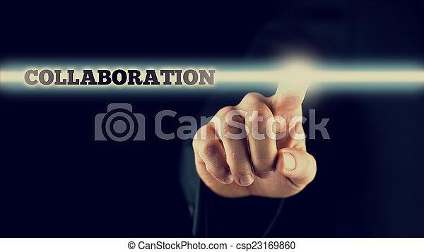 Businessman activating a Collaboration button on virtual screen - csp23169860