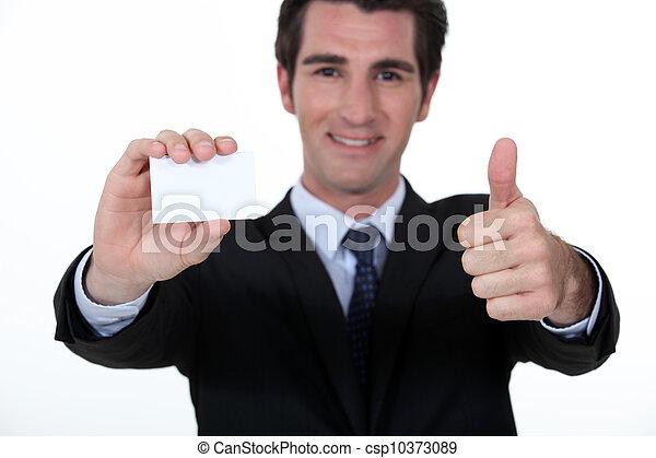 Businessman advertising his company via business card - csp10373089