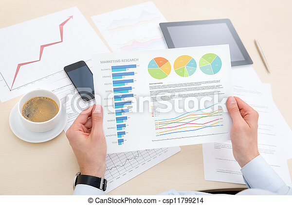 Businessman analyzing information on the chart - csp11799214