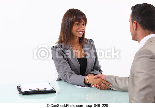 Businessman and businesswoman shaking hands - csp10461228