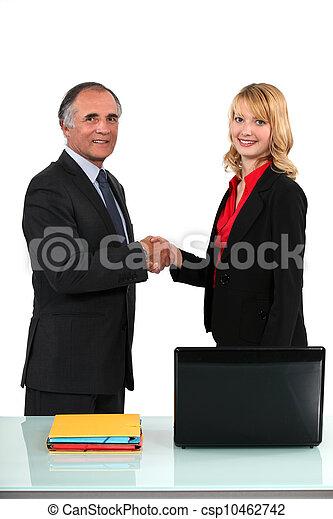 businessman and businesswoman shaking hands - csp10462742