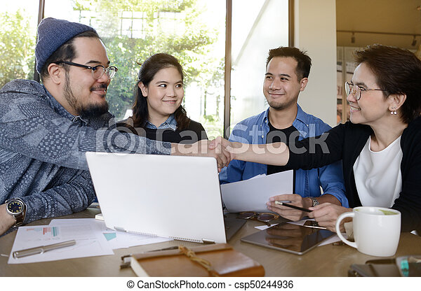 Businessman and businesswoman shaking hands for business agreement - csp50244936