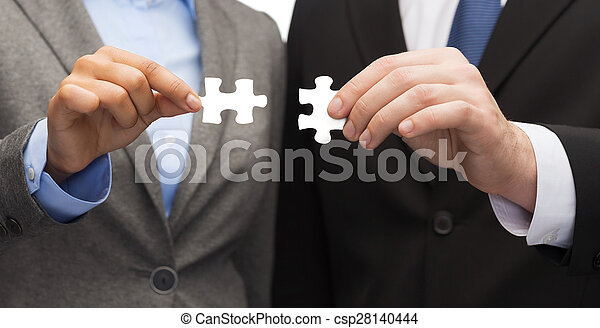 businessman and businesswoman with puzzle pieces - csp28140444