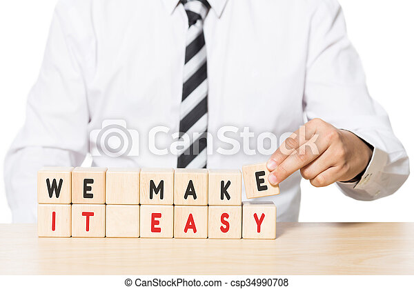 Businessman Arranging Wooden Blocks with we make it easy words - csp34990708