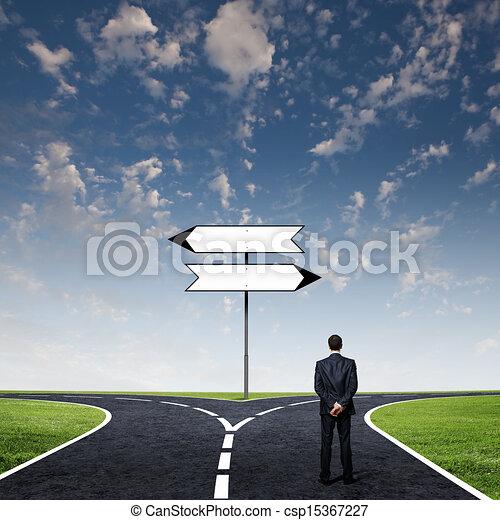 Businessman at crossroads - csp15367227