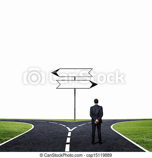 Businessman at crossroads - csp15119889