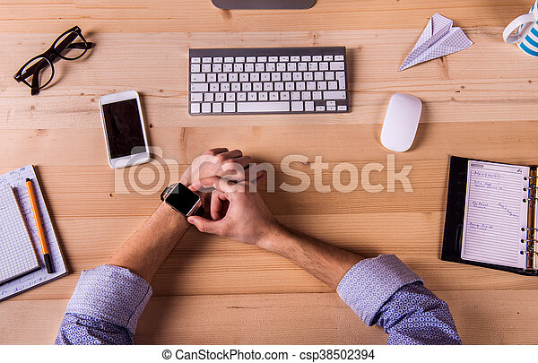 Businessman at the desk, office gadgets and supplies - csp38502394