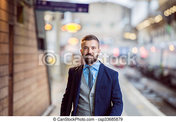 Businessman at the station - csp33685879