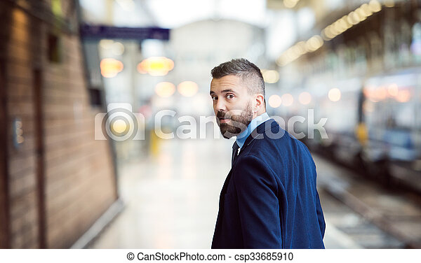 Businessman at the station - csp33685910