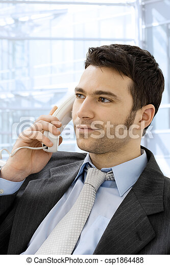 Businessman calling on phone - csp1864488