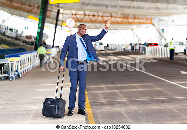 businessman calling taxi in airport - csp13254602