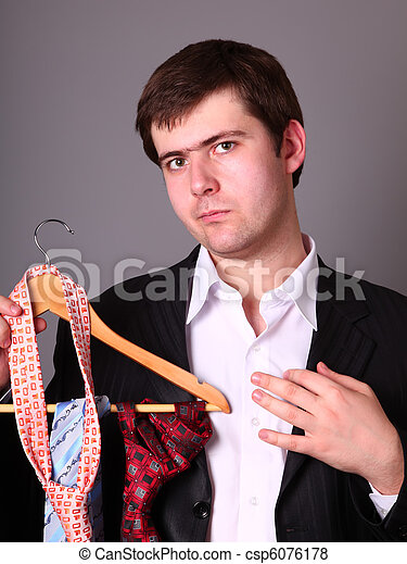 Businessman can't select a tie - csp6076178