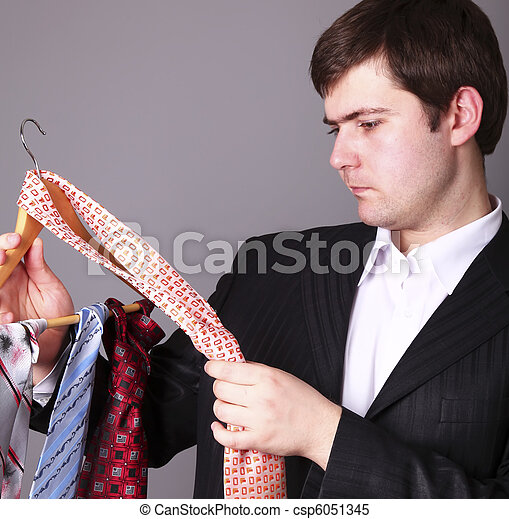 Businessman can't select a tie - csp6051345