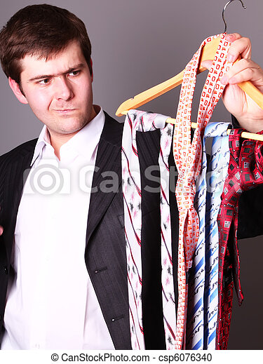 Businessman can't select a tie - csp6076340