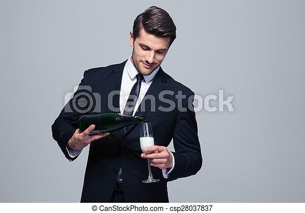 Businessman celebrating success, pouring champagne - csp28037837