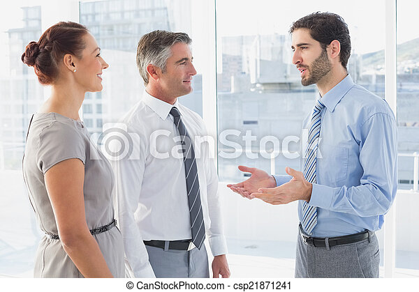 Businessman chatting with co-worker - csp21871241