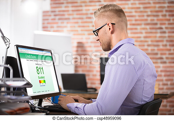 Businessman Checking Credit Score On Computer - csp48959096