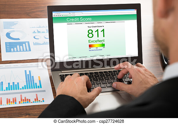 Businessman Checking Credit Score - csp27724628