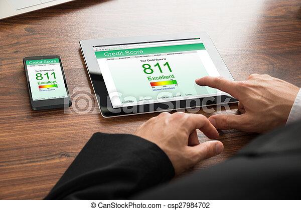 Businessman Checking Credit Score - csp27984702