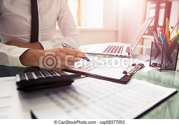 Businessman Checking Invoice - csp58377053