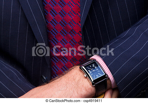 Businessman checking the time on his watch - csp4919411