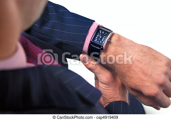 Businessman checking the time on his watch - csp4919409