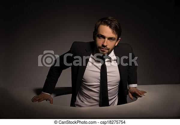 Businessman Climbing Out Of A Circular Hole Csp18275754