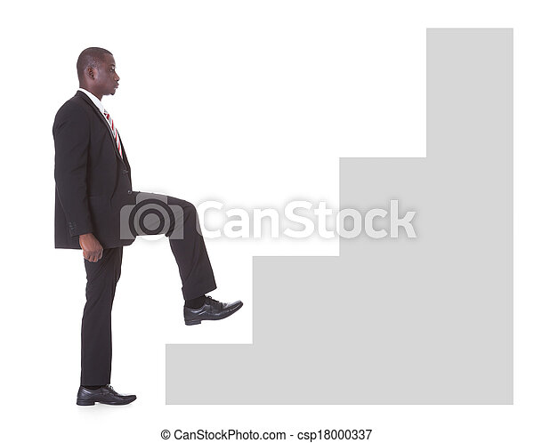 portrait of young african businessman climbing steps on white