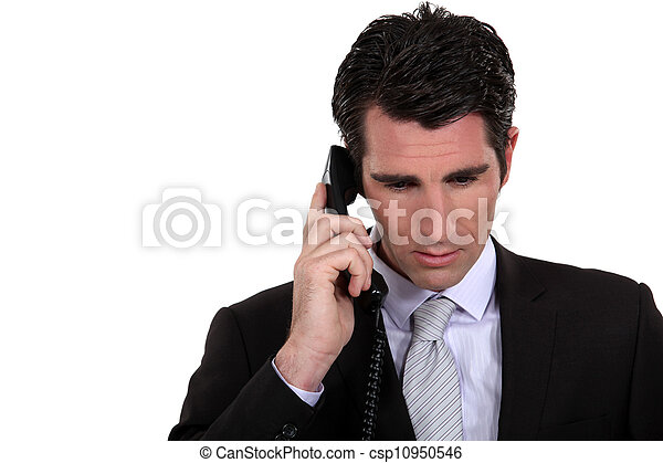 Businessman  concentrating during call - csp10950546