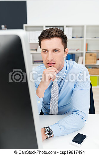 Businessman concentrating on his work - csp19617494