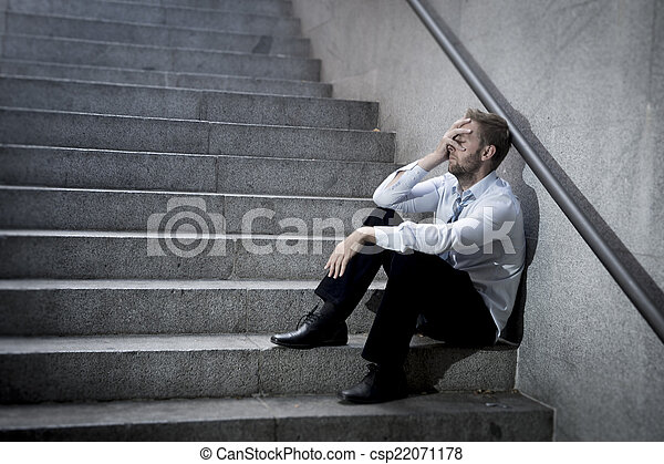 businessman crying lost in depression sitting on street concrete stairs - csp22071178