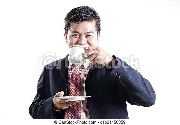 Businessman drink the coffee - csp21456359