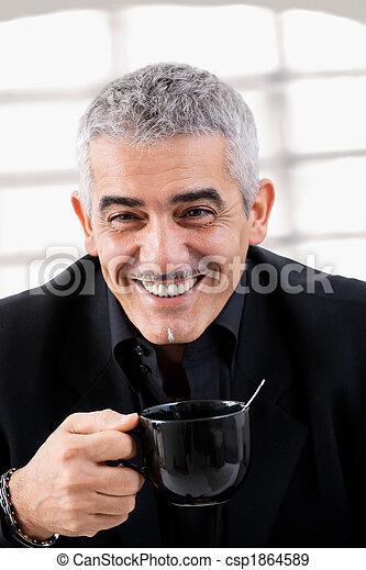 Businessman drinking tea - csp1864589