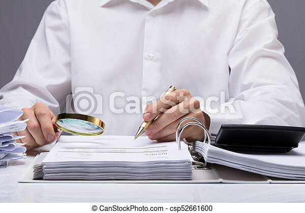 Businessman Examining Invoice With Magnifying Glass - csp52661600