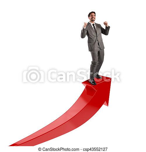 Businessman exults for economic success - csp43552127