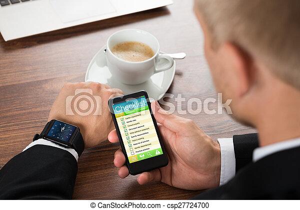 Businessman Filling Checklist Form - csp27724700