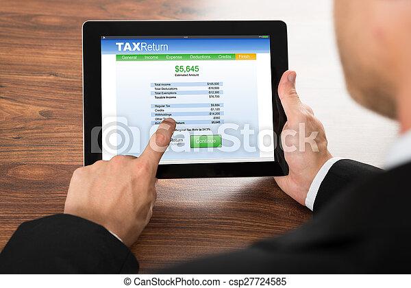 Businessman Filling Tax Return Form - csp27724585