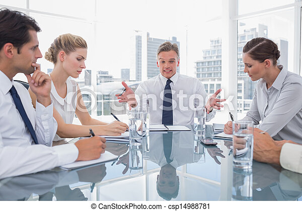 Businessman gesturing during a meeting - csp14988781