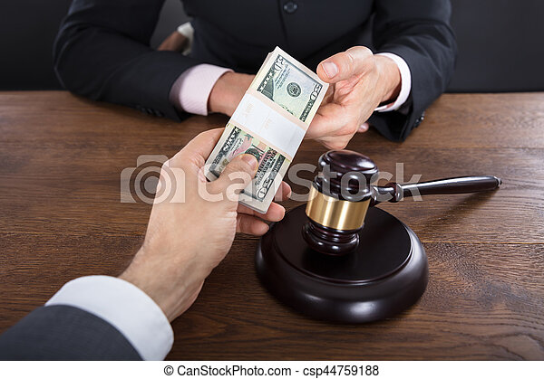 businessman-giving-a-bribe-to-a-judge-pi